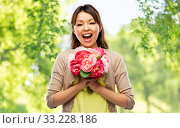 happy laughing asian woman with bunch of flowers. Стоковое фото, фотограф Syda Productions / Фотобанк Лори