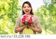 Купить «happy laughing asian woman with bunch of flowers», фото № 33228186, снято 11 мая 2019 г. (c) Syda Productions / Фотобанк Лори