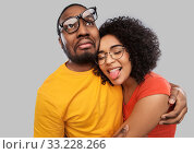 Купить «happy african american couple in glasses hugging», фото № 33228266, снято 15 декабря 2019 г. (c) Syda Productions / Фотобанк Лори