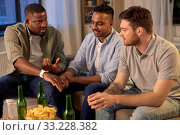 Купить «male friends with smart watch and beer at home», фото № 33228382, снято 28 декабря 2019 г. (c) Syda Productions / Фотобанк Лори