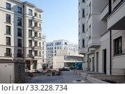 Купить «New residential buildings on the former Freudenberg site in Holteistrasse Strasse in Berlin-Friedrichshain», фото № 33228734, снято 14 октября 2018 г. (c) Caro Photoagency / Фотобанк Лори