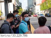 Купить «Singapore, Republic of Singapore, men with mouthguards in Chinatown», фото № 33229786, снято 24 января 2020 г. (c) Caro Photoagency / Фотобанк Лори