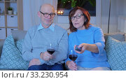 Купить «happy senior couple drink red wine and watch tv», видеоролик № 33230954, снято 4 января 2020 г. (c) Syda Productions / Фотобанк Лори