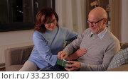 Купить «happy senior couple with gift box at home», видеоролик № 33231090, снято 4 января 2020 г. (c) Syda Productions / Фотобанк Лори