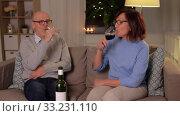 Купить «happy senior couple with glasses of red wine», видеоролик № 33231110, снято 4 января 2020 г. (c) Syda Productions / Фотобанк Лори