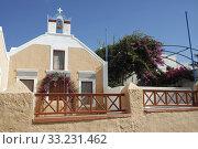 traditional church in small village oia on santorini. Стоковое фото, фотограф Christian Schnoor / PantherMedia / Фотобанк Лори