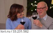 Купить «happy senior couple with glasses of red wine», видеоролик № 33231582, снято 4 января 2020 г. (c) Syda Productions / Фотобанк Лори