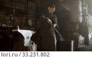 Купить «Cooling out hot metal detail in the bucket of cool water», видеоролик № 33231802, снято 8 апреля 2020 г. (c) Константин Шишкин / Фотобанк Лори