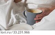 Купить «hand of woman eating croissant with coffee in bed», видеоролик № 33231966, снято 22 января 2020 г. (c) Syda Productions / Фотобанк Лори