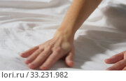 hands of woman making bed linen. Стоковое видео, видеограф Syda Productions / Фотобанк Лори