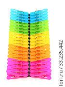 Colorful plastic clothespins on a white background. Стоковое фото, фотограф Akiyoko Yokoyama / PantherMedia / Фотобанк Лори