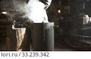 Купить «Blacksmith forging - Cooling out detail in the bucket of cool water», видеоролик № 33239342, снято 8 апреля 2020 г. (c) Константин Шишкин / Фотобанк Лори