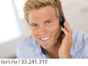 Купить «Smiling attractive customer service representative», фото № 33241310, снято 28 марта 2020 г. (c) PantherMedia / Фотобанк Лори