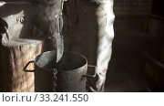 Купить «Blacksmith cooling out hot knife - steam comes off the blade», видеоролик № 33241550, снято 8 апреля 2020 г. (c) Константин Шишкин / Фотобанк Лори