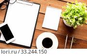 Купить «clipboard, smartphone, cup of coffee and notebook», видеоролик № 33244150, снято 2 апреля 2020 г. (c) Syda Productions / Фотобанк Лори