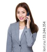 Купить «Young Businesswoman talk to mobile phone», фото № 33244354, снято 8 апреля 2020 г. (c) PantherMedia / Фотобанк Лори