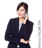 Купить «Asian businesswoman talk to cellphone», фото № 33245154, снято 7 апреля 2020 г. (c) PantherMedia / Фотобанк Лори