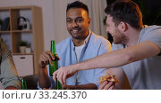 Купить «happy male friends with beer eating pizza at home», видеоролик № 33245370, снято 12 января 2020 г. (c) Syda Productions / Фотобанк Лори