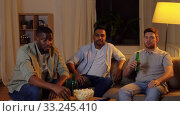 Купить «happy male friends with beer watching tv at home», видеоролик № 33245410, снято 12 января 2020 г. (c) Syda Productions / Фотобанк Лори