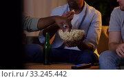 Купить «happy male friends with beer watching tv at home», видеоролик № 33245442, снято 12 января 2020 г. (c) Syda Productions / Фотобанк Лори