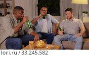 Купить «male friends drinking beer with crisps at home», видеоролик № 33245582, снято 12 января 2020 г. (c) Syda Productions / Фотобанк Лори