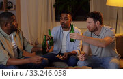 Купить «happy male friends with beer eating pizza at home», видеоролик № 33246058, снято 17 февраля 2020 г. (c) Syda Productions / Фотобанк Лори