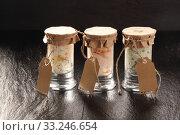 Купить «Trio of Jars Filled with Savory Sauces», фото № 33246654, снято 30 марта 2020 г. (c) PantherMedia / Фотобанк Лори