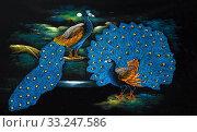 silk towel black with blue peacock motif. Стоковое фото, фотограф Edgar Mantel / PantherMedia / Фотобанк Лори