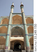 Architecture details of the Amir Chakhmaq Mosque complex facade at Yadz,  Iran. The mosque is located in a square with the same name. The prominent structure has a three storey elaborate facade of symmetrical sunken arched alcoves. Стоковое фото, фотограф Maurizio Bersanelli / PantherMedia / Фотобанк Лори