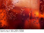 Купить «Macro view of cold cola in a glass with ice cubes», фото № 33251558, снято 15 июля 2020 г. (c) age Fotostock / Фотобанк Лори