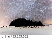 Купить «The Milky Way over the winter mountain landscape with s silhouette of pine trees in the foreground. Geminids Meteor Shower. Falling stars. Comet mode.», фото № 33255562, снято 13 июля 2020 г. (c) age Fotostock / Фотобанк Лори
