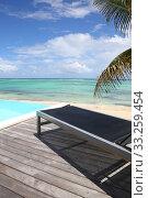 Купить «Infinity pool with deck chair by the beach», фото № 33259454, снято 8 апреля 2020 г. (c) PantherMedia / Фотобанк Лори
