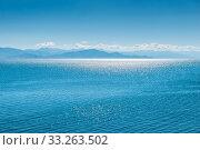 Купить «Lake Sevan in Armenia, sun glare on the water surface of the lake on a sunny day», фото № 33263502, снято 6 июня 2018 г. (c) Константин Лабунский / Фотобанк Лори