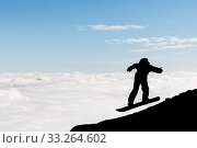 The silhouette of a freestyle snowboarder jumping from the top of a peak of Vitosha mountain covered with clouds. He is participating in an freestyle competition of skiers and snowboarders. Стоковое фото, фотограф Zoonar.com/Cylonphoto / age Fotostock / Фотобанк Лори