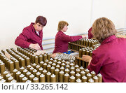 Sopot, Bulgaria - May 17, 2016: Female workers are checking explosive elements of anti tank rocket-propelled grenades (RPG, bazooka) near the assembly line in a munition factory. Редакционное фото, фотограф Zoonar.com/Cylonphoto / age Fotostock / Фотобанк Лори