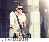Купить «man with bicycle and smartphone on city street», фото № 33269886, снято 21 августа 2016 г. (c) Syda Productions / Фотобанк Лори
