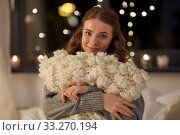 happy young woman with soft pillow in bed at home. Стоковое фото, фотограф Syda Productions / Фотобанк Лори