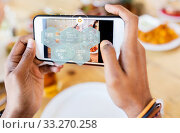 Купить «hands with phone and food nutritional value chart», фото № 33270258, снято 2 мая 2017 г. (c) Syda Productions / Фотобанк Лори