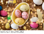 chocolate egg and candy drops on wooden table. Стоковое фото, фотограф Syda Productions / Фотобанк Лори