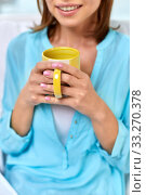 Купить «close up of happy woman with cup of tea or coffee», фото № 33270378, снято 20 декабря 2013 г. (c) Syda Productions / Фотобанк Лори