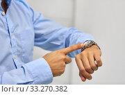 Купить «close up of businessman looking at wristwatch», фото № 33270382, снято 5 апреля 2014 г. (c) Syda Productions / Фотобанк Лори