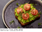 toast bread with mashed avocado and cherry tomato. Стоковое фото, фотограф Syda Productions / Фотобанк Лори