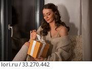 Купить «woman with christmas gift at home at night», фото № 33270442, снято 19 января 2020 г. (c) Syda Productions / Фотобанк Лори