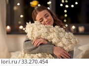 Купить «happy young woman with soft pillow in bed at home», фото № 33270454, снято 19 января 2020 г. (c) Syda Productions / Фотобанк Лори