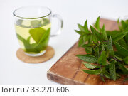 Купить «herbal tea with fresh peppermint on wooden board», фото № 33270606, снято 12 июля 2018 г. (c) Syda Productions / Фотобанк Лори