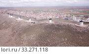 Купить «Picturesque rural landscape of Consuegra with famous windmills in sunny day, Spain», видеоролик № 33271118, снято 23 апреля 2019 г. (c) Яков Филимонов / Фотобанк Лори