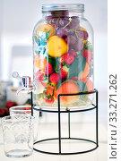 Купить «Glass jar beverage dispenser filled with fresh fruits and berries», фото № 33271262, снято 26 января 2020 г. (c) Alexander Tihonovs / Фотобанк Лори