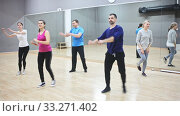 Dance class for adult people, positive young and mature men and women training in dance studio. Стоковое видео, видеограф Яков Филимонов / Фотобанк Лори