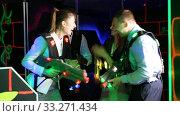 Купить «Men and women in business suits playing laser tag emotionally in dark room», видеоролик № 33271434, снято 25 мая 2020 г. (c) Яков Филимонов / Фотобанк Лори