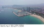 Купить «Aerial panoramic view of modern Barcelona cityscape on Mediterranean coast», видеоролик № 33271550, снято 7 июля 2019 г. (c) Яков Филимонов / Фотобанк Лори